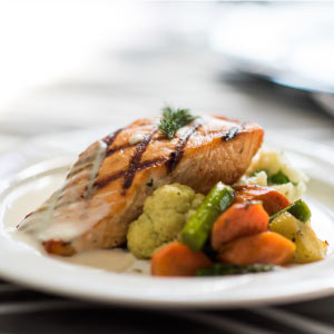 Salmon with grilled vegetables.