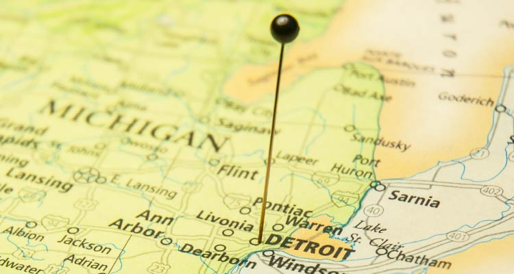 A pin in a map of Michigan on Detroit.