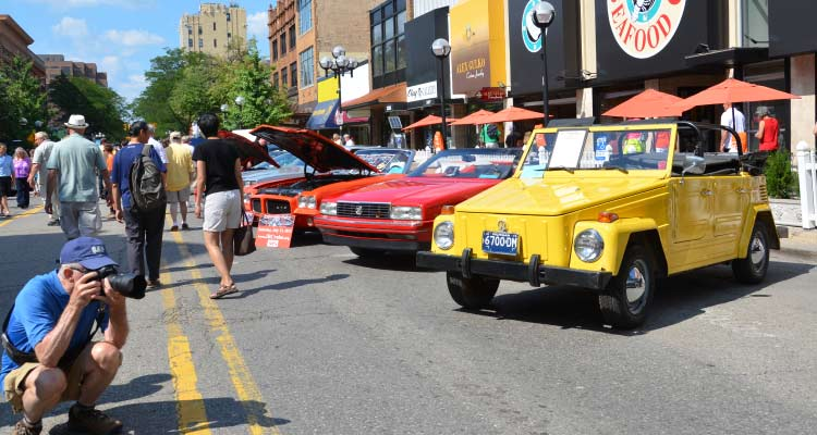 A line of vintage cars at the car show.
