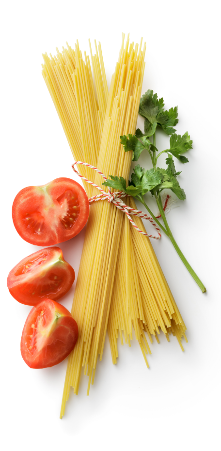 Fresh sliced tomatoes, uncooked pasta, and parsley