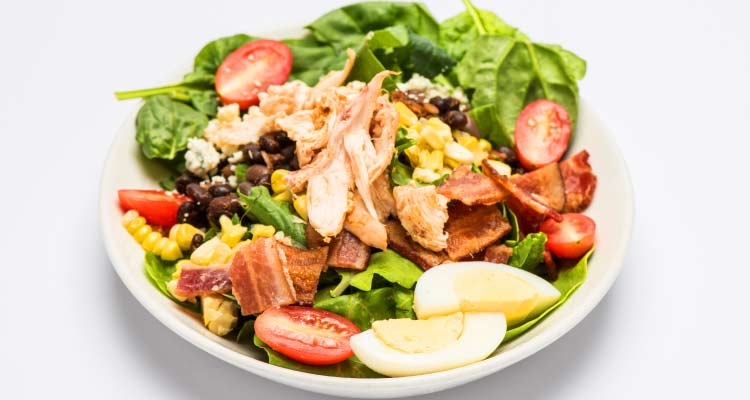 A full plate of cobb salad.