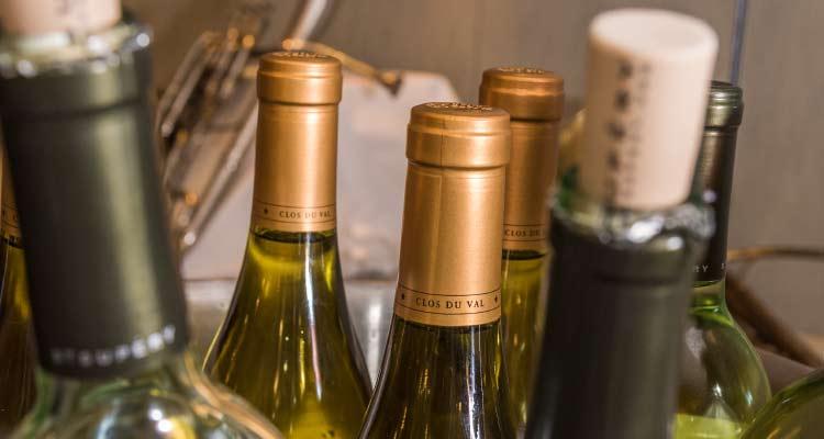 A bucket of wine bottles.
