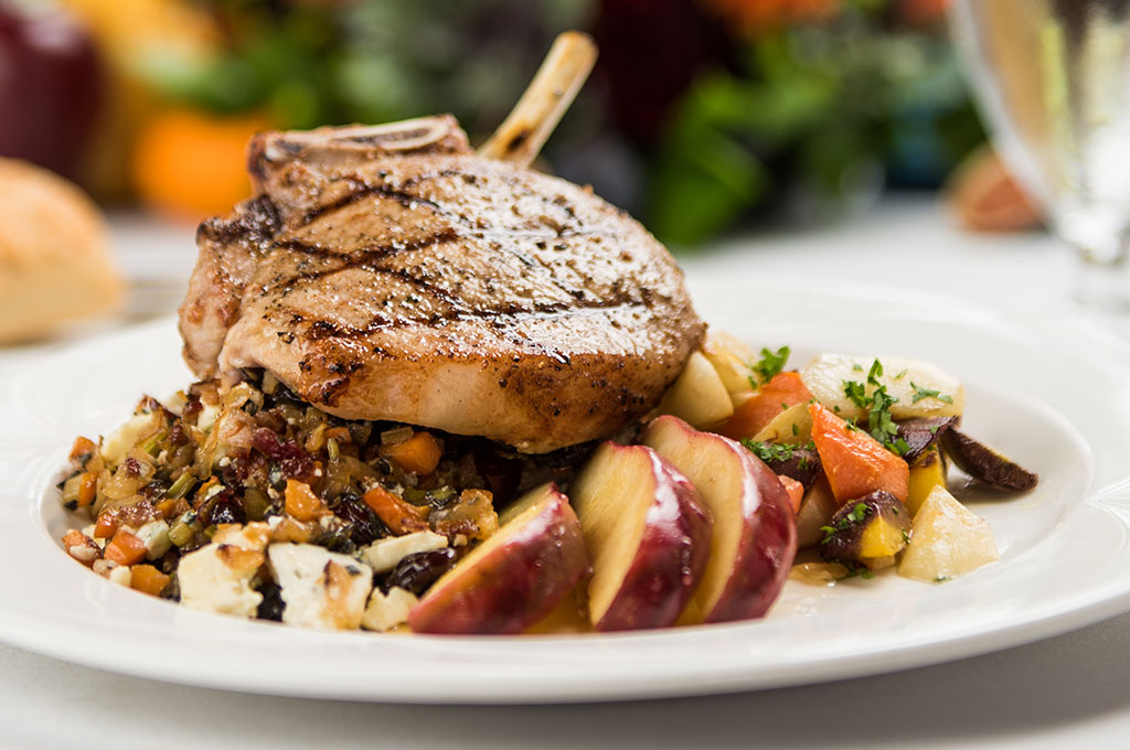 Stuffed pork chops with butternut squash risotto and roasted root vegetables