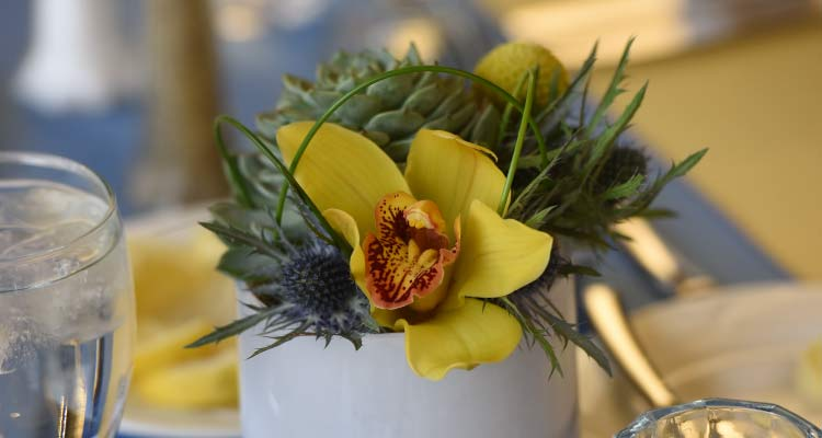 Flowers on a table setting.